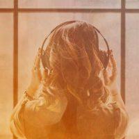 woman listening to playlist on headphones