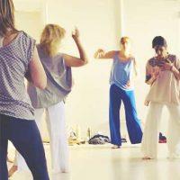 people dancing inside movement meditation