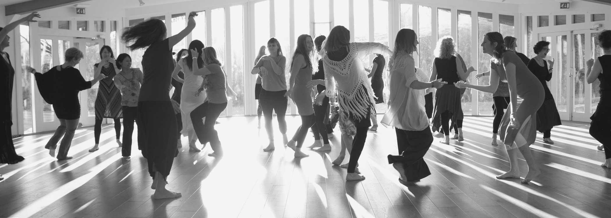people dancing movement medicine in a workshop